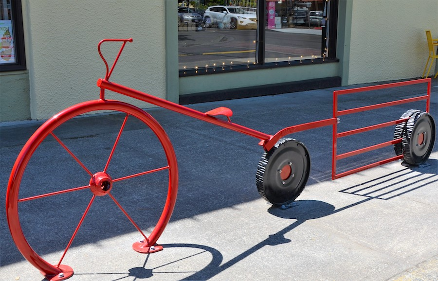 Red bike rack wagon next to iCandy.